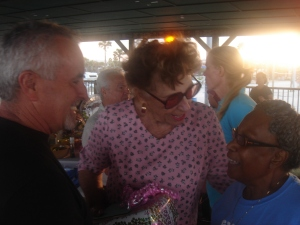 mom at her party with her mike, her dentist and gloria, her fishing pal