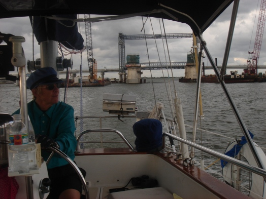 Captain Priscilla of Ace Lady at the helm
